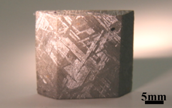 Fig. 1	Metallic microstructure observed in Widmanstatten structure of iron meteorites